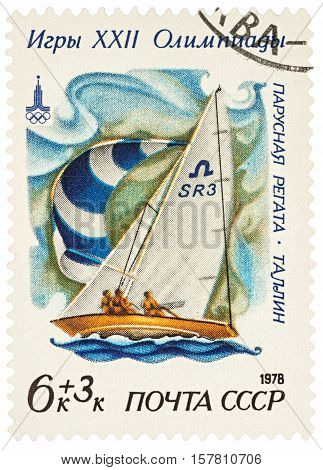 MOSCOW RUSSIA - NOVEMBER 22 2016: A stamp printed in USSR (Russia) shows racing yacht in Soling class in Tallinn series