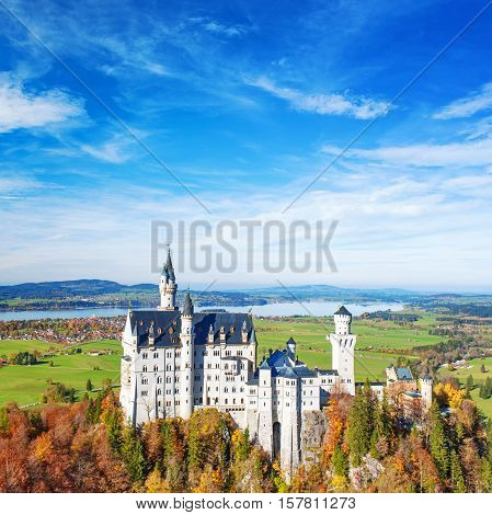 Neuschwanstein Castle in fall. Landmark of Germany and Bavaria.