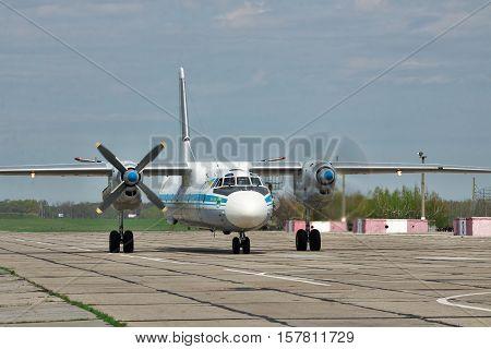 Vasilkov Ukraine - April 24 2012: Ukraine Air Force Antonov An-26 cargo plane is starting the engines before takeoff