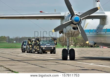 Vasilkov Ukraine - April 24 2012: Anti-terrorist operation team is approaching the plane to free the hostages