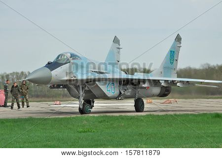 Vasilkov Ukraine - April 24 2012: Ukraine Air Force MiG-29 is taxiing to the runway for takeoff into another flight