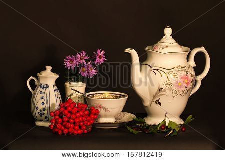 Tea still life / Tea still life with flowers and berries