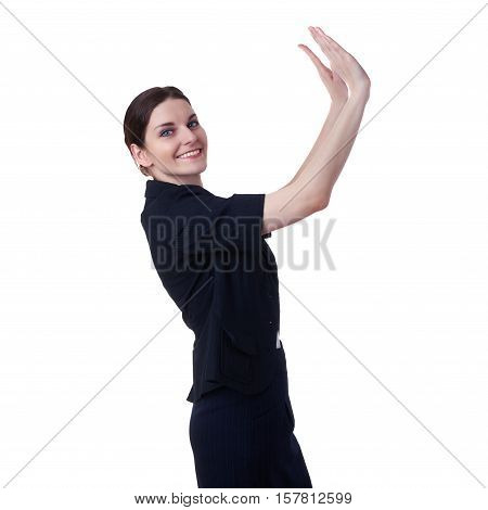 Smiling businesswoman standing over white isolated background holding or pushing lifting up something heavy falling, business, education, office concept