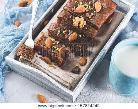 Chocolate Cake With Almonds On Wooden Tray