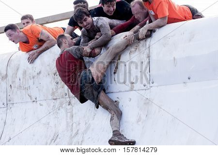 HAMPSHIRE UK - SEPTEMBER 26 2015: Tough Mudder is a team-oriented 18-20 km obstacle course testing strength and mental grit. It is not a timed race but a team challenge with world-class obstacles.