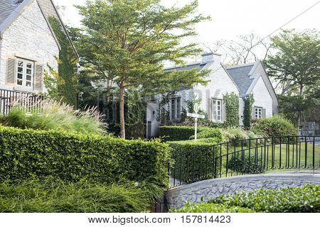 Upscale suburban house with garden and bridge