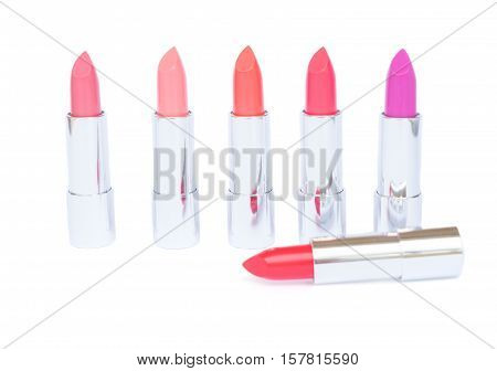 Collection of puple, pink and red shades of open lipsticks isolated on white background