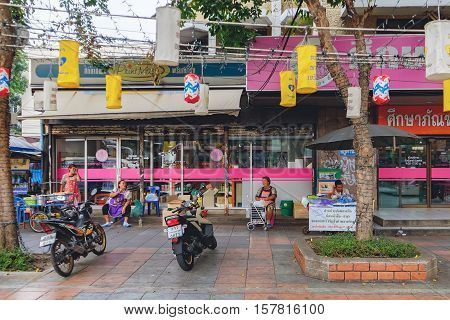 Bangkok, Thailand - December 23, 2015: Street life in Bangkok. Smiling food vendors on Ratchadamnoen road. It famous district with low budget hotels and guesthouses area in Bangkok Thailand.