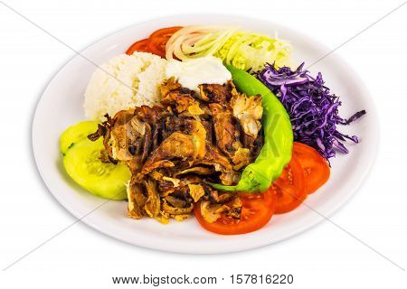 Kebab turkish cuisine with chicken meat rice salad and yogurt