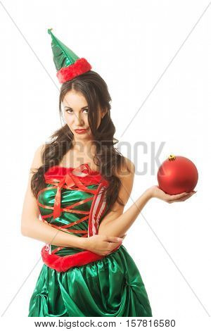 Serious woman holding christmas bubble on the left hand