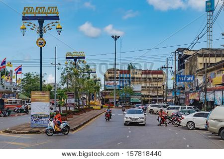 Surat Thani, Thailand - December 26, 2015: Everyday street life of the provinces of Thailand. Lifestyle and culture of Suratthani. Street scape view of the bustling tourist town.