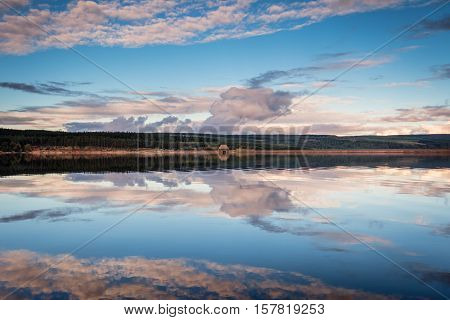 Reflected Sky in Kielder Reservoir, Kielder Water and Forest Park in Northumberland has the largest man made lake in Northern Europe. The reservoir sits in the North Tyne Valley with the river flowing through it