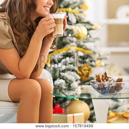Happy Young Woman Enjoying Latte Macchiato Near Christmas Tree