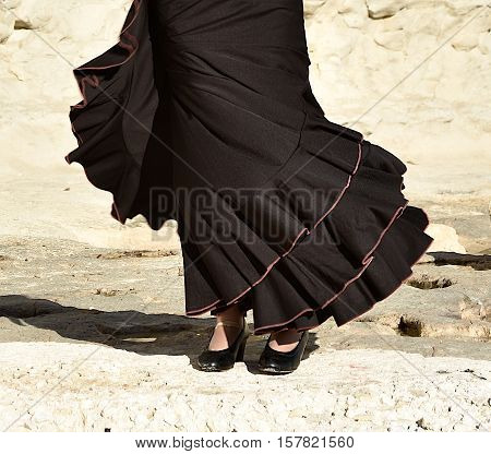 Photo of flamenco dancer. Legs fragment photo of spanish flamenco dancer.  Only legs cropped