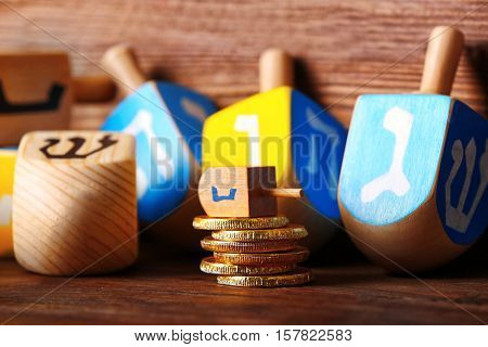Dreidels for Hanukkah on wooden table, close up