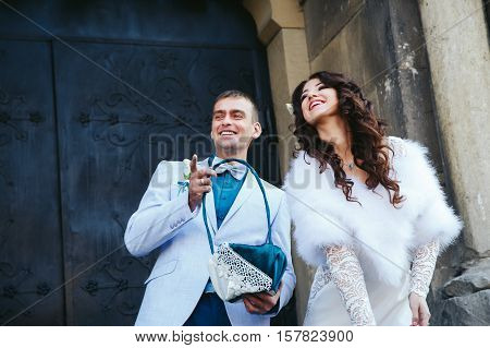 Bride and fiance laugh while throwing the rice after engagement