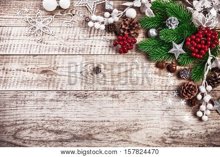 Christmas festive background with pinecone balls. Holiday greeting card branch old wooden board rustic style, copyspace and top view