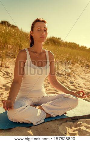 female doing exercises on the beach