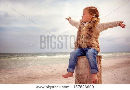 wide coastline autumn little child