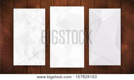 Set of tree white wrinkled paper on dark wooden background, triangular illustration