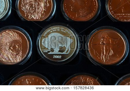 Special coin edition.American dollar in hand of numismatics