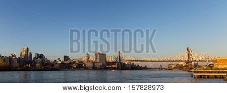 Panoramic view of the Queensboro Bridge over the East River in New York City