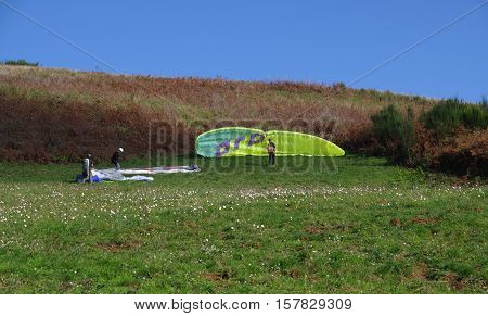 ROCCA PRIORA ITALY - NOVEMBER 1 2016: paragliding lesson paragliders set their wings