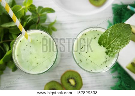 Kiwi milk shakes with mint close up