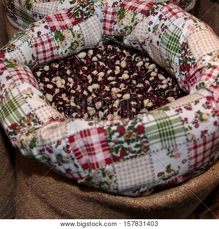 Red Calypso Beans inside Jute Sack for Sale at Market