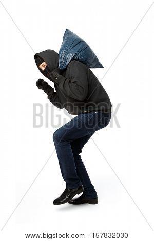 Burglar steals with large bag