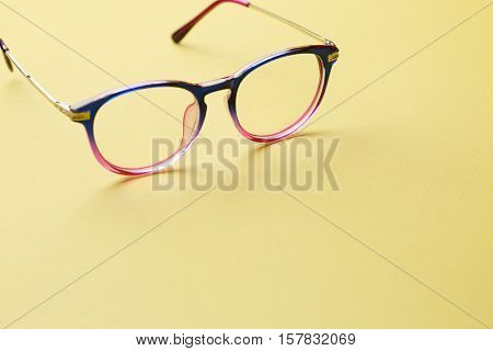 Multi-colored glasses on empty space