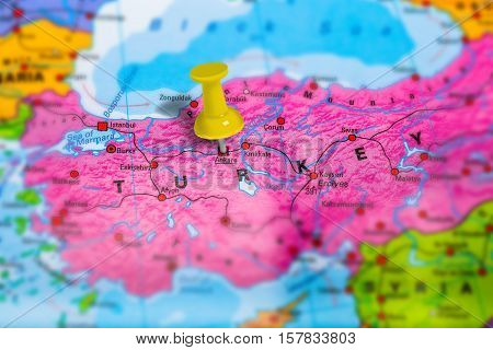 Ankara capital city in Turkey pinned on colorful political map of europe. Geopolitical school atlas. Tilt shift effect. poster
