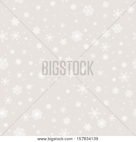 Christmas seamless pattern with white snowflakes on gray background