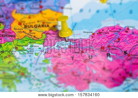 Istanbul city in Turkey pinned on colorful political map of europe. Geopolitical school atlas. Tilt shift effect.