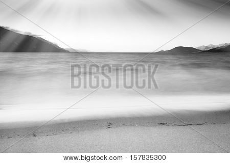 Black and white tidal waves with light leak landscape background hd