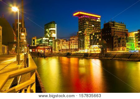 Colorful Night Scene Of Rhein River At Night In Dusseldorf