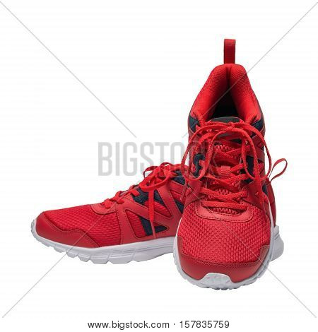 Red sport running shoes isolated on white background