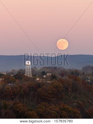 MORGANTOWN WEST VIRGINIA USA - NOVEMBER 13: Harvest Supermoon rises over the campus of West Virginia University in Morgantown WV on November 13 2016. This moon is the closest to the earth for several decades.