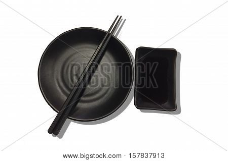 Top view of chopsticks with empty bowl Japanese sushi chopsticks and soy sauce bowl on white background.