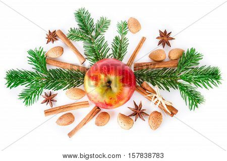 Christmas festive arrangement with apple and christmas spices on white. Top view.