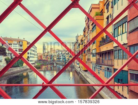 historical jewish quarter in Girona, view through Eiffel Bridge at sunrise, Barcelona, Spain, Catalonia