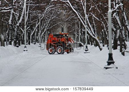 Moscow Russia - February 02 2015: Snowplow cleans from the road snow on Tverskoy boulevard in Moscow