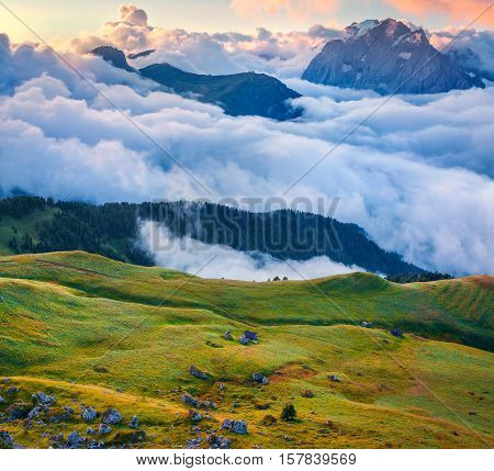 View Of The Foggy Val Di Fassa Valley With Passo Sella