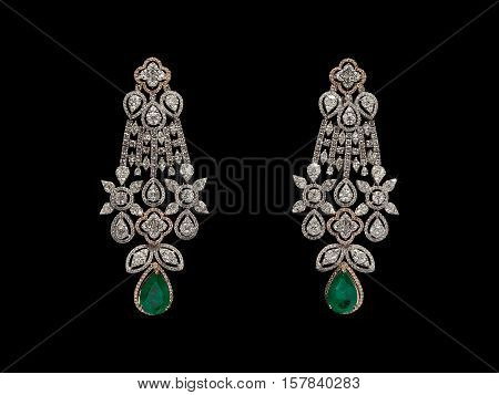 Pair of Earrings with diamonds isolated over black background