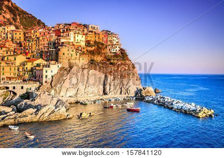 Manarola Liguria Italy. The wonderful Manarola village as you can see it from the mountain above. Quiet sky and peaceful sea during sunset.