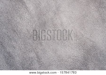Suede leather grey texture. suede grey structure