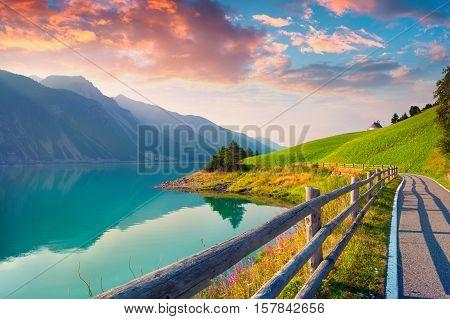 Bicycle Path Around Resia Lake In The Italian Alps.