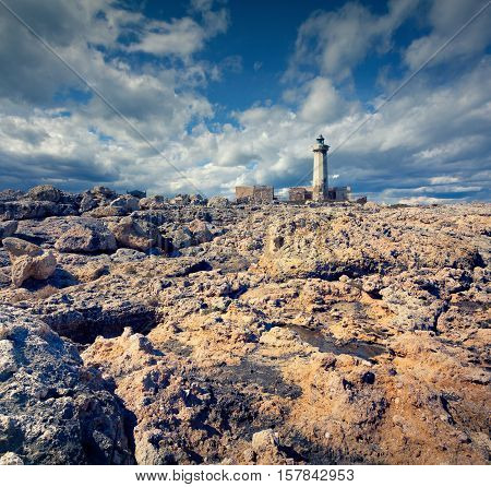 Old Lighthouse On The Murro Di Porco Cape