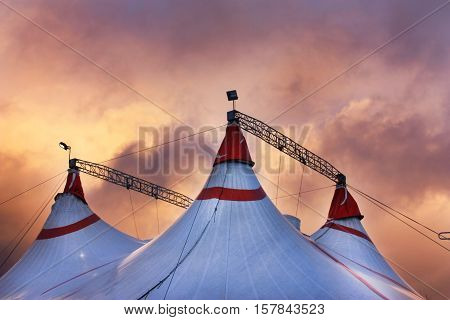 Circus tent under the dramatic sunset sky