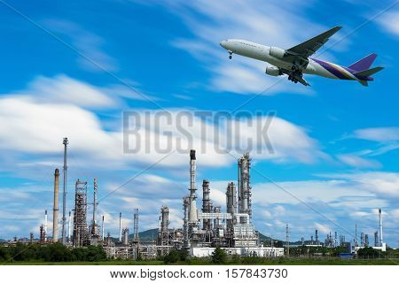 Airplane In The Sky Over Oil Refinery Factory Industry